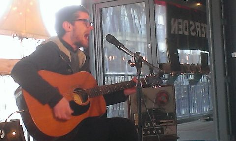 guitar player singing